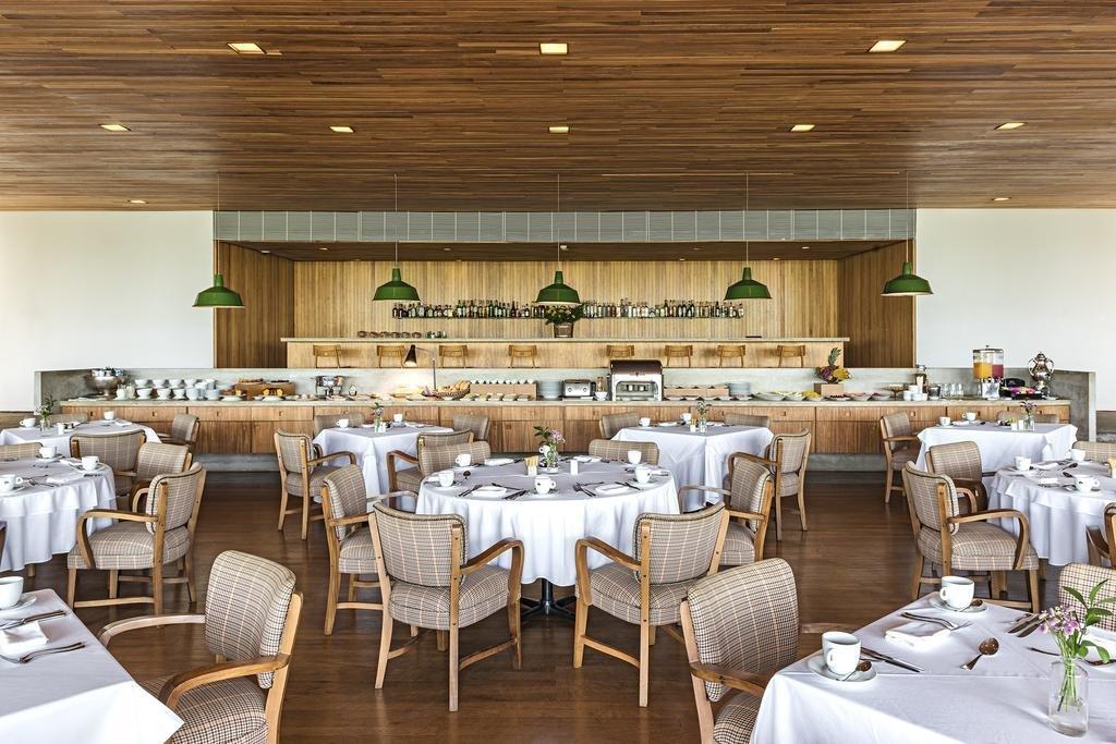Dining Room, Pendant Lighting, Table, Chair, Recessed Lighting, and Medium Hardwood Floor  Fasano Boa Vista