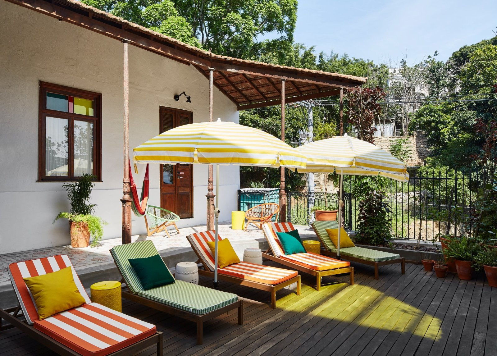 Outdoor, Metal Fences, Wall, Back Yard, Trees, Tile Patio, Porch, Deck, Decking Patio, Porch, Deck, Hanging Lighting, Vertical Fences, Wall, and Large Patio, Porch, Deck  Mama Shelter Rio De Janeiro