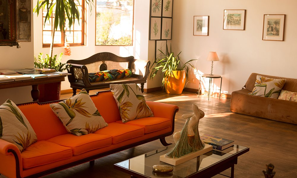 Living Room, Table Lighting, Chair, Console Tables, Sofa, End Tables, Medium Hardwood Floor, Lamps, and Coffee Tables  Mama Ruisa Boutique Hotel