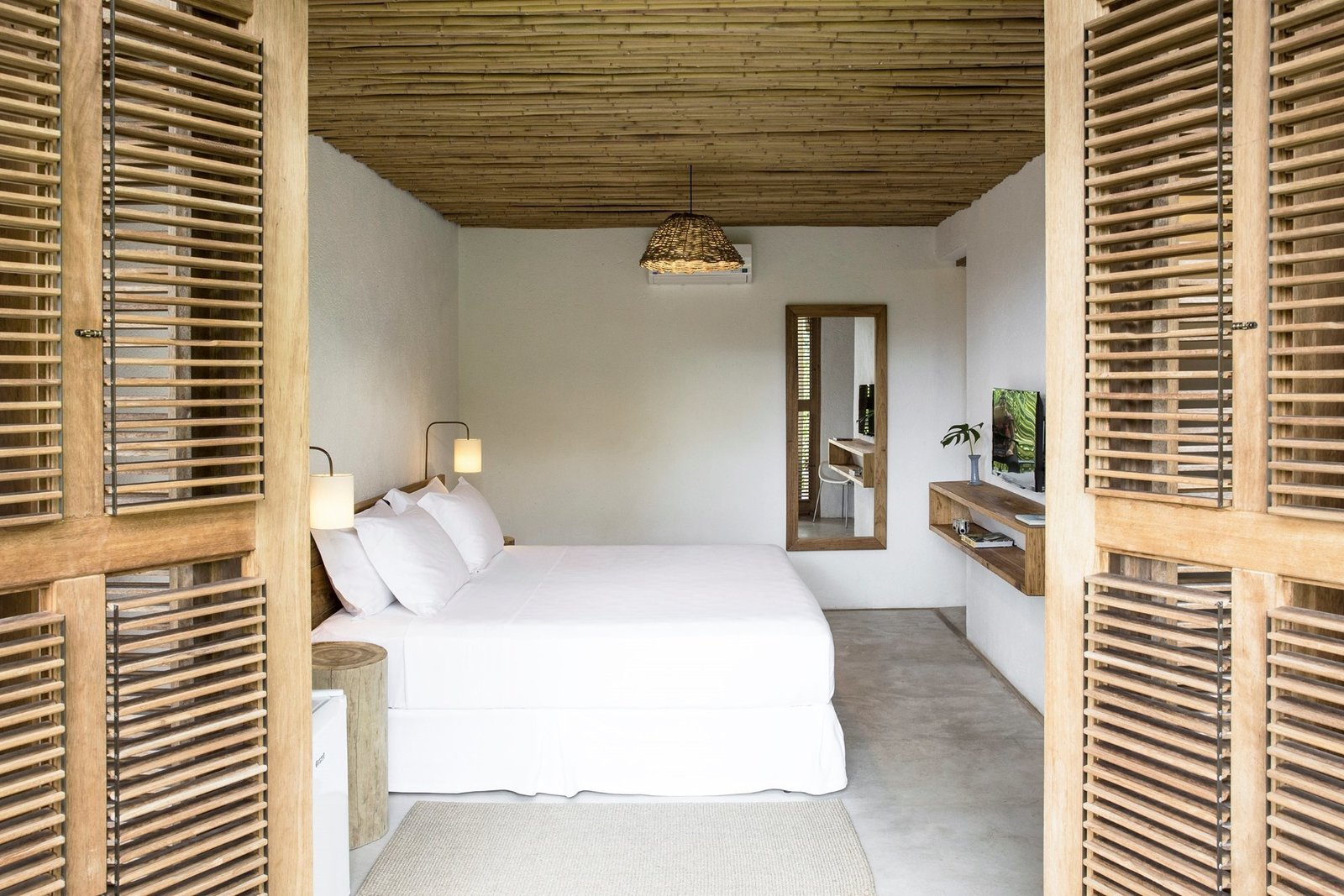 Bedroom, Wall, Rug, Bed, Concrete, and Pendant  Best Bedroom Bed Rug Concrete Wall Photos from Casa Mar Paraty