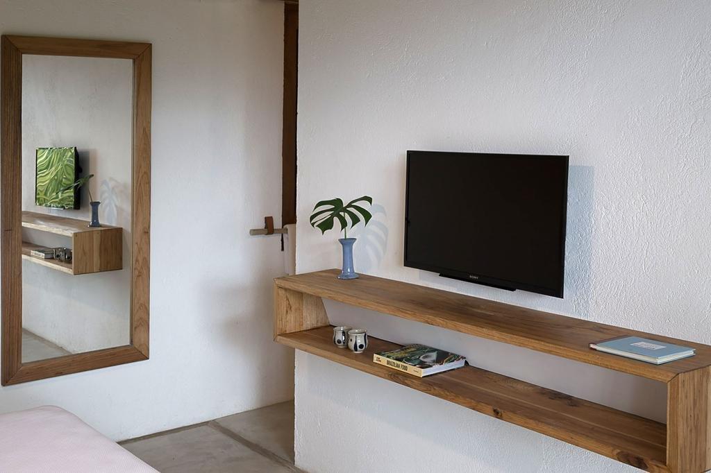Bedroom, Concrete Floor, and Bed  Casa Mar Paraty