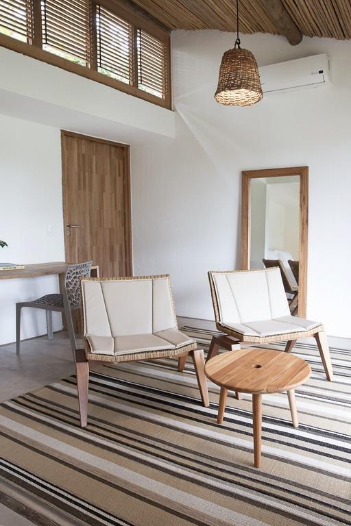 Living Room, Chair, Coffee Tables, Pendant Lighting, Rug Floor, and Concrete Floor  Casa Mar Paraty