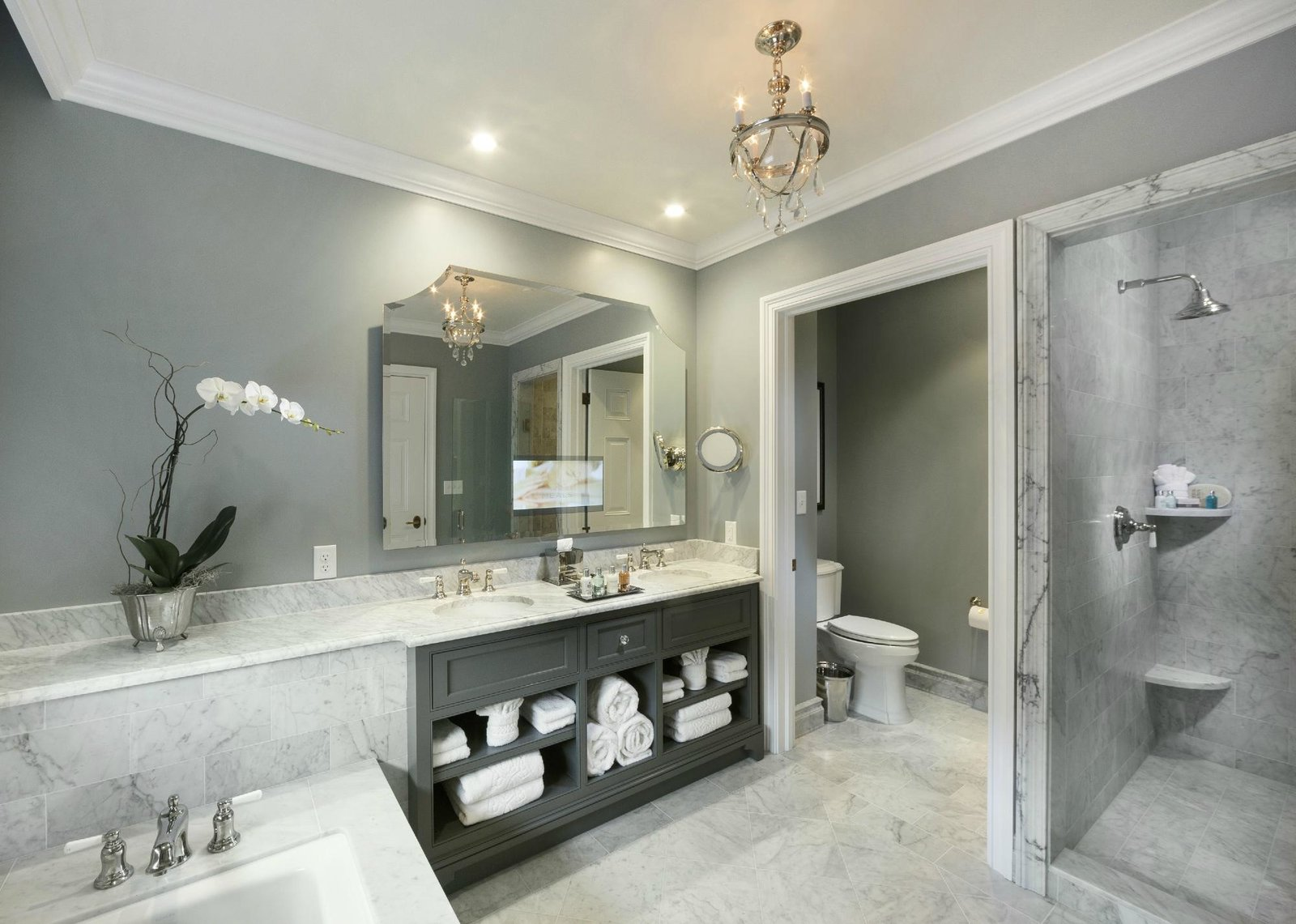 Bath Room, Marble Counter, Two Piece Toilet, Undermount Tub, Pendant Lighting, Undermount Sink, Marble Floor, Corner Shower, and Recessed Lighting  Jefferson Hotel
