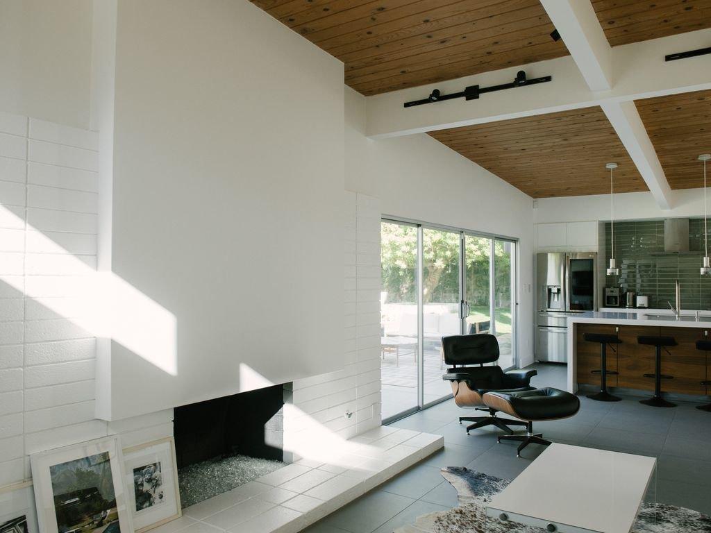 Living Room, Rug Floor, Coffee Tables, Slate Floor, Wood Burning Fireplace, Pendant Lighting, Chair, Track Lighting, and Ottomans  Le Mode PS