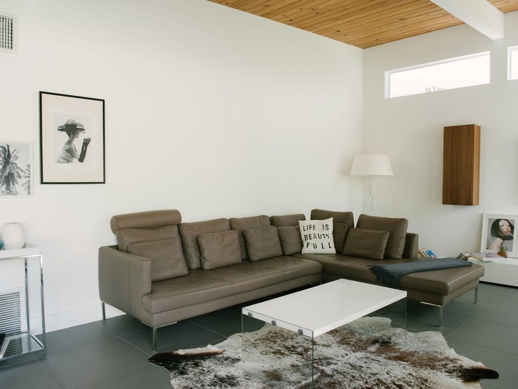 Living Room, Coffee Tables, Sectional, Slate Floor, Lamps, Table Lighting, and Rug Floor  Le Mode PS