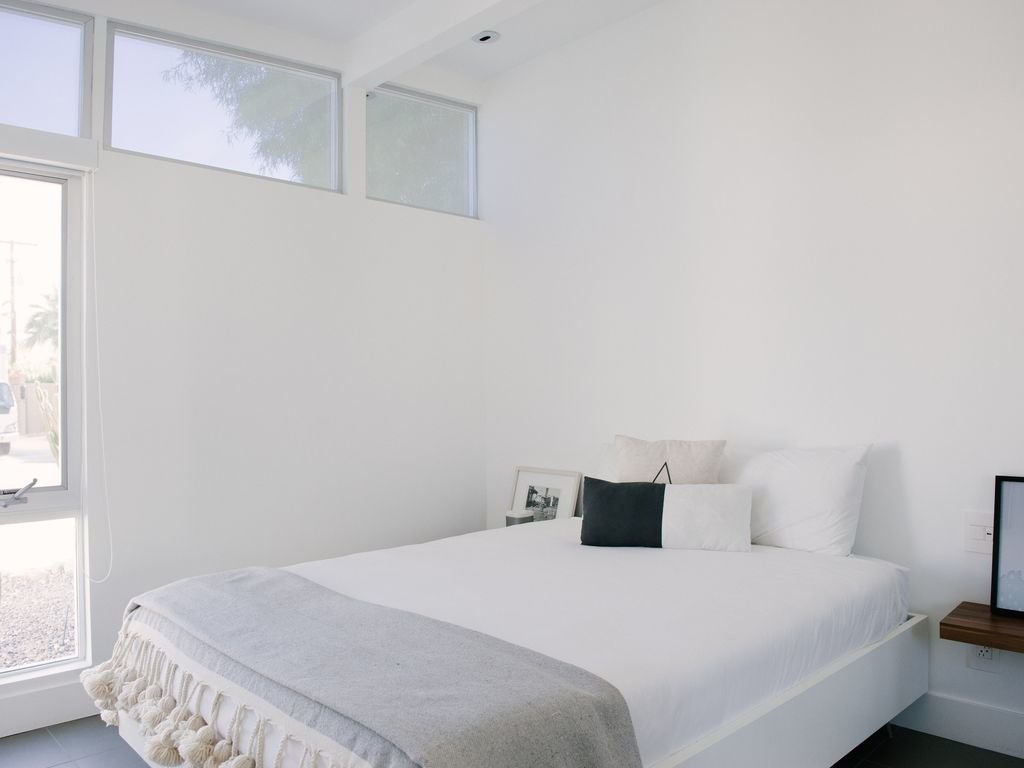 Bedroom, Recessed Lighting, Night Stands, Slate Floor, and Bed  Le Mode PS
