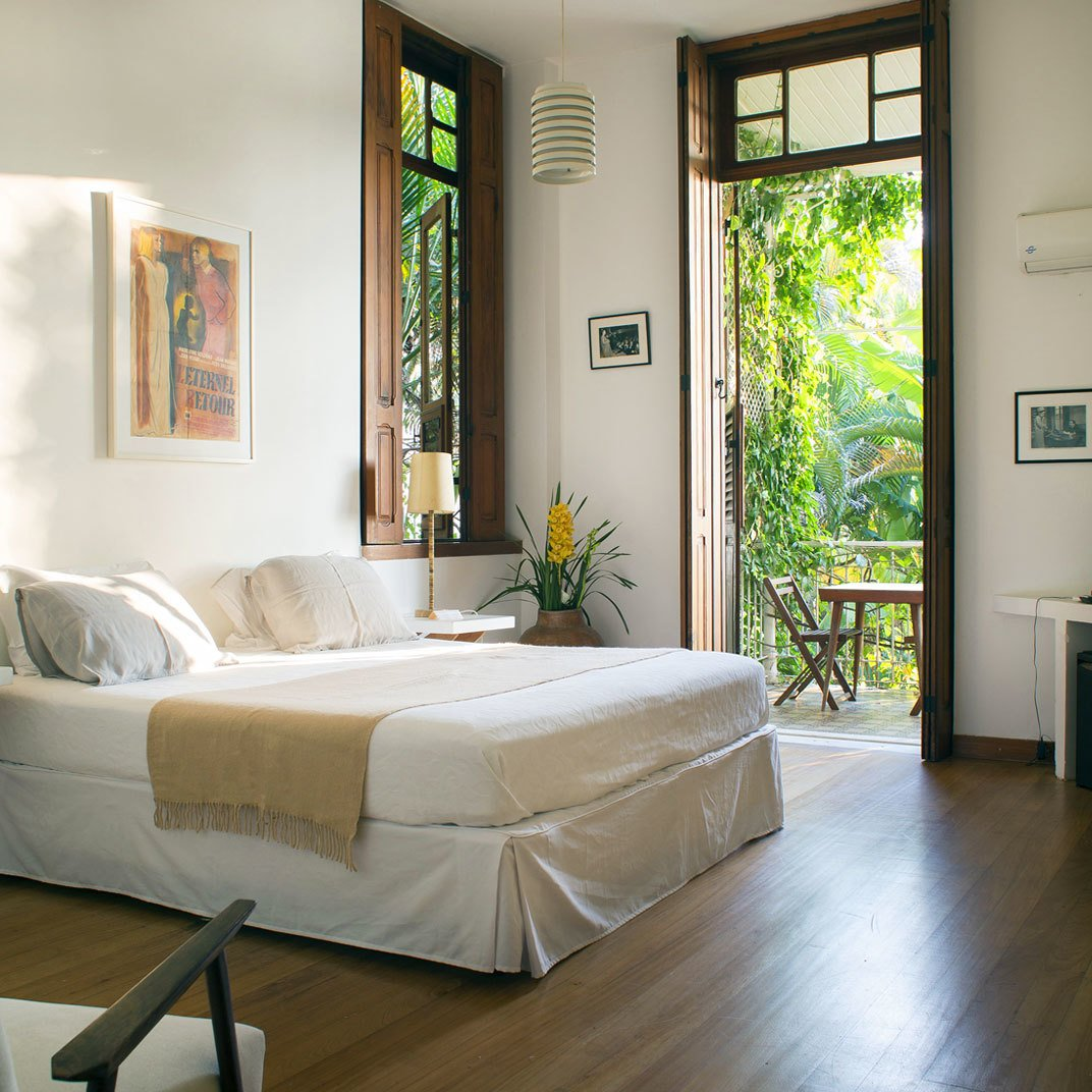 Bedroom, Bed, Night Stands, Table Lighting, and Medium Hardwood Floor  Mama Ruisa Boutique Hotel