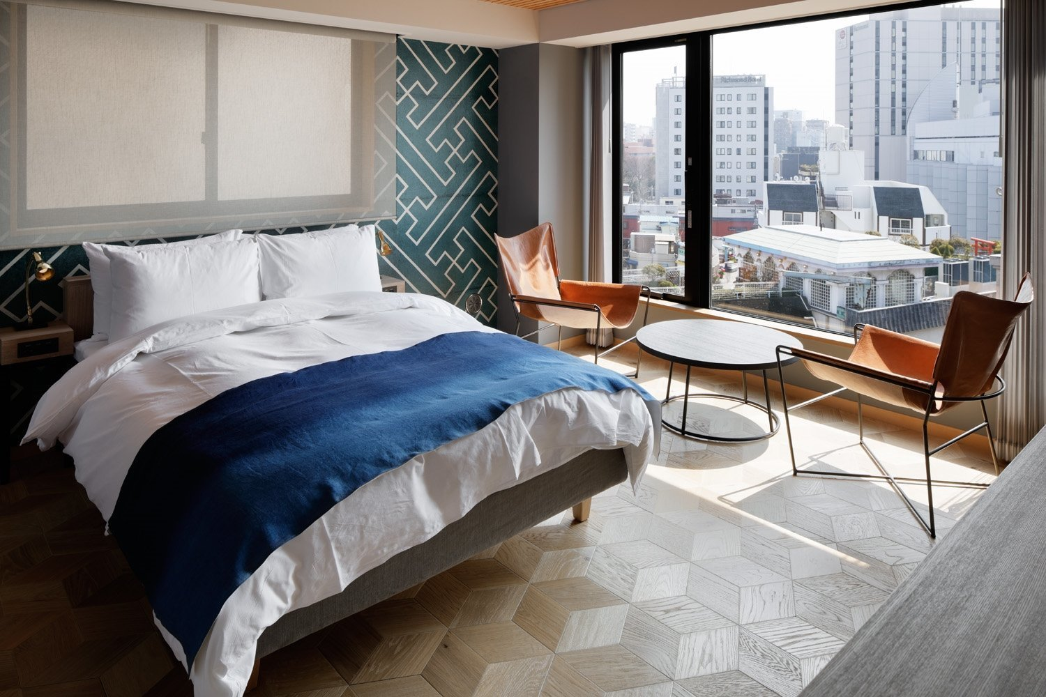 Bedroom, Chair, Night Stands, Table Lighting, Bed, and Medium Hardwood Floor  Wired Hotel Asakusa