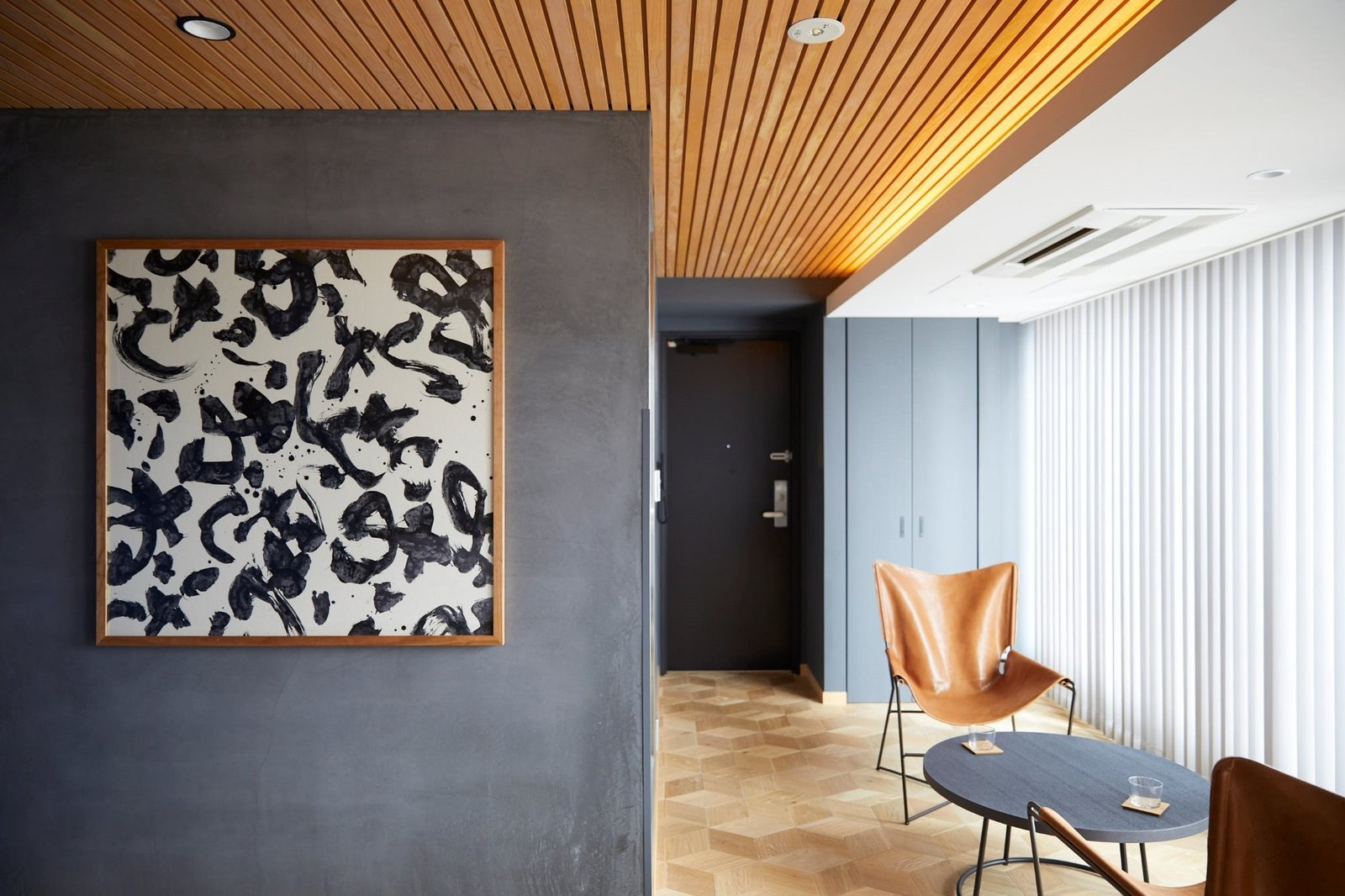 Living Room, Chair, Recessed Lighting, Coffee Tables, and Medium Hardwood Floor  Wired Hotel Asakusa