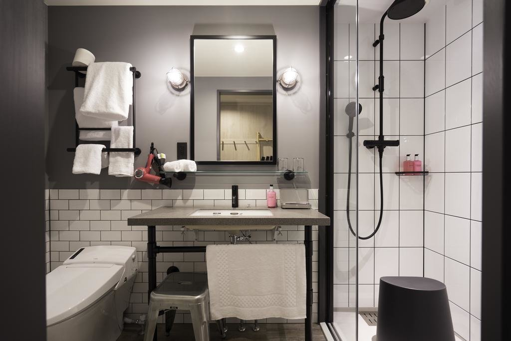 Bath Room, Corner Shower, Wall Lighting, Undermount Sink, and One Piece Toilet  Moxy Osaka Honmachi