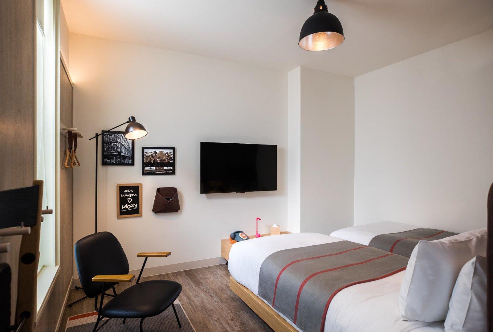 Bedroom, Bed, Floor Lighting, Ceiling Lighting, Chair, and Dark Hardwood Floor  Moxy Osaka Honmachi