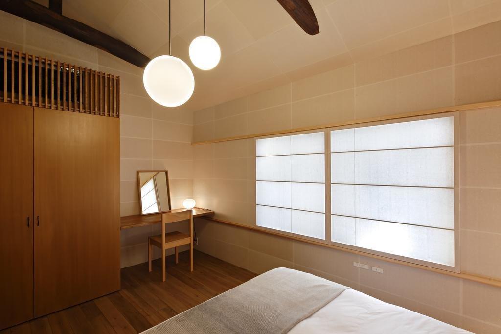 Bedroom, Chair, Pendant, Bed, and Medium Hardwood  Bedroom Pendant Chair Bed Photos from Kyomachiya Hotel Shiki Juraku