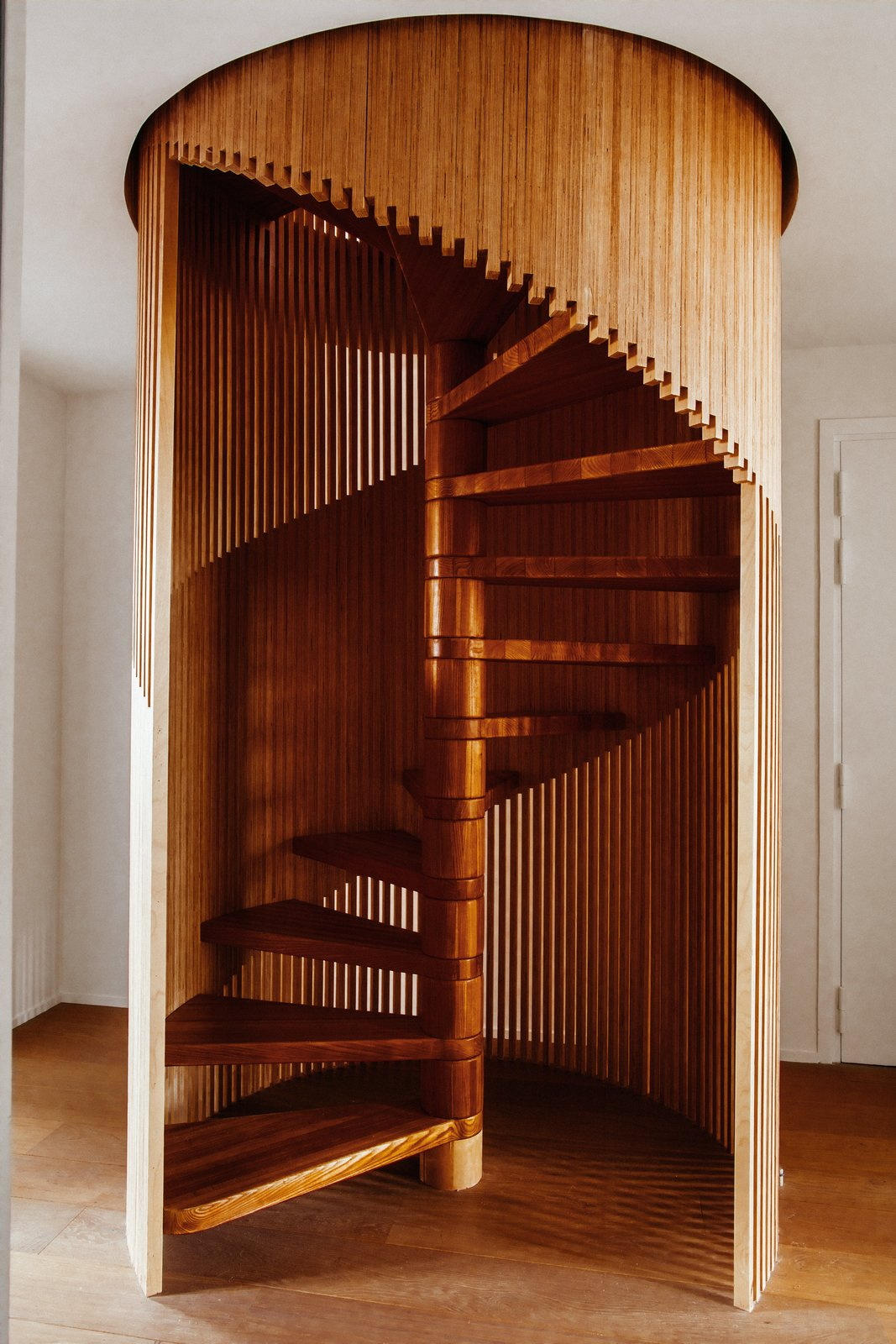 Staircase, Wood Railing, and Wood Tread  Best Photos from This Live/Work Duplex in Paris Is Full of Kid- and Cat-Friendly Details