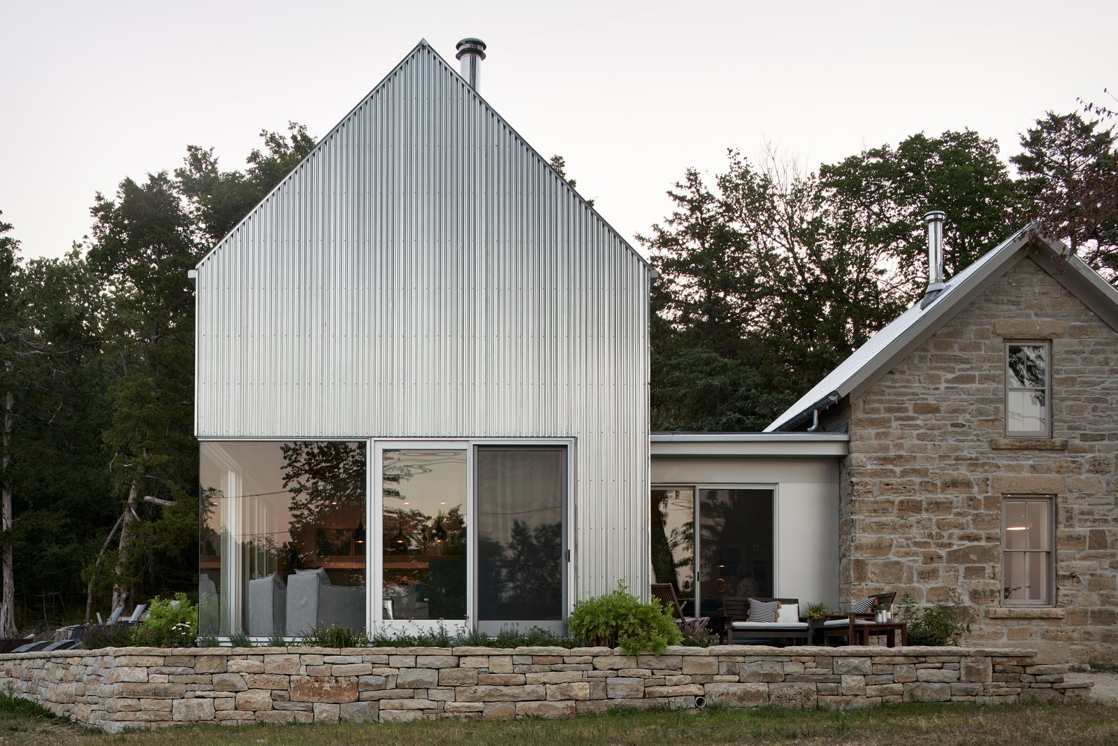 Exterior, Gable RoofLine, Stone Siding Material, Metal Roof Material, Metal Siding Material, and House Building Type  Best Photos from A Limestone Cottage in Kansas Is Reborn With a Corrugated Steel Addition