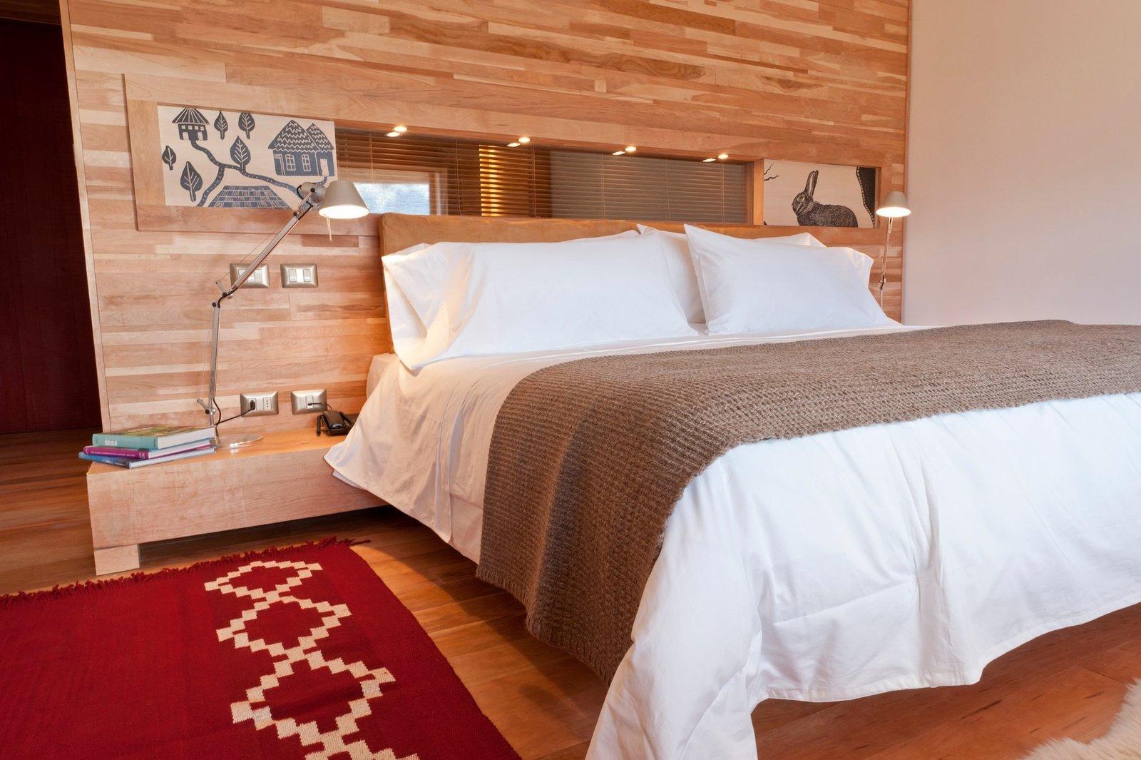 Bedroom, Bed, Medium Hardwood Floor, Table Lighting, Night Stands, and Rug Floor  Tierra Patagonia Hotel & Spa