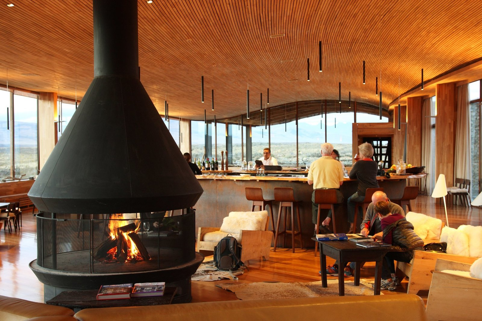 Living Room, Bar, Wood Burning Fireplace, Chair, Stools, Floor Lighting, and Ceiling Lighting  Tierra Patagonia Hotel & Spa