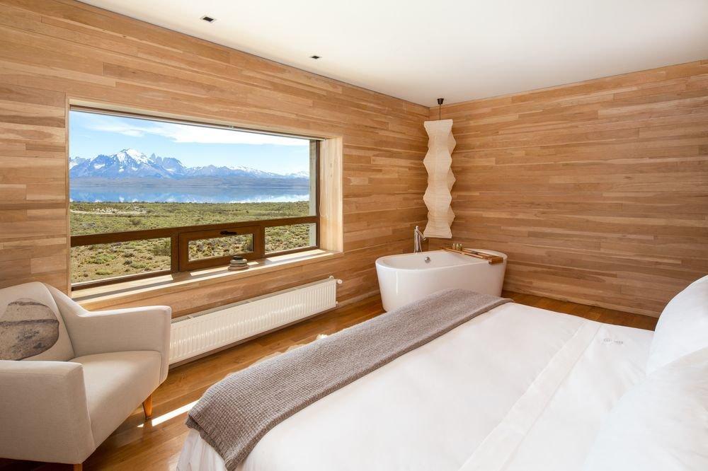 Bedroom, Medium Hardwood Floor, Recessed Lighting, Bed, Chair, and Ceiling Lighting  Tierra Patagonia Hotel & Spa