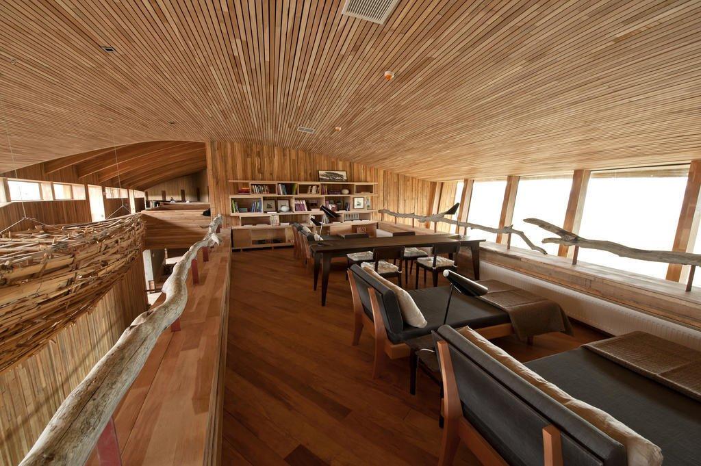 Living Room, Shelves, Chair, Ceiling Lighting, and Medium Hardwood Floor  Tierra Patagonia Hotel & Spa