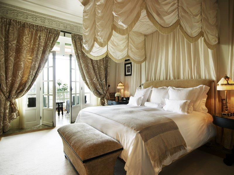 Bedroom, Lamps, Night Stands, Bed, Table, Rug, and Porcelain Tile  Bedroom Bed Porcelain Tile Photos from La Mamounia