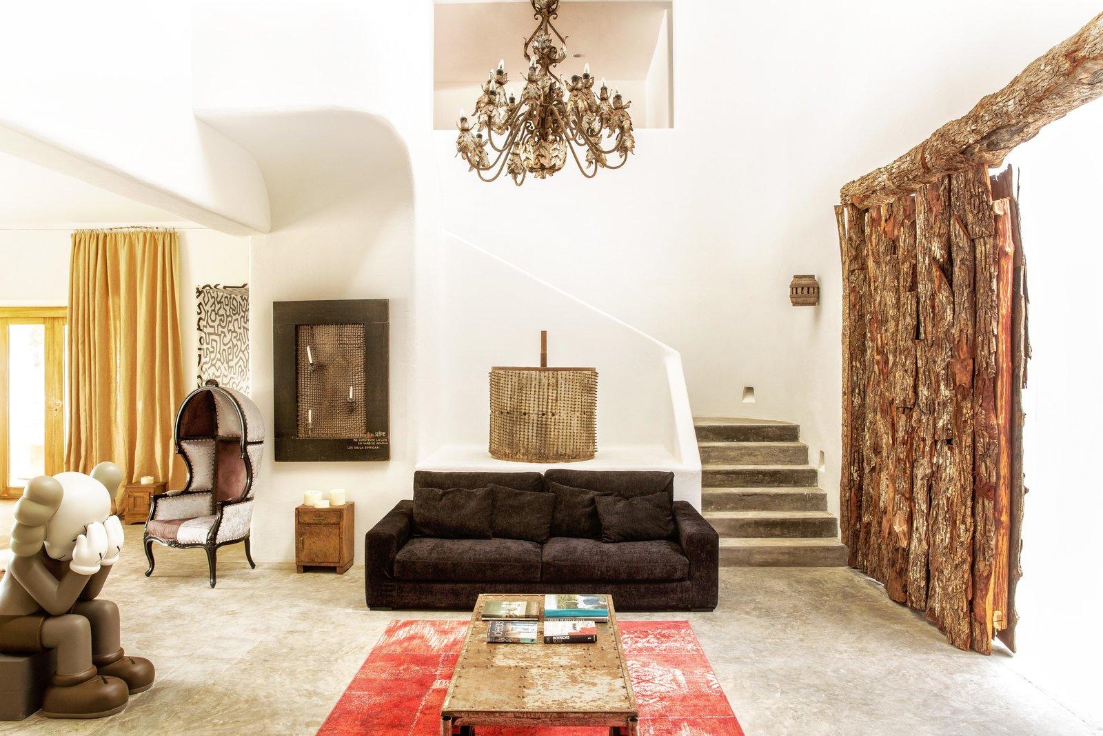 Living Room, Rug Floor, End Tables, Sofa, Pendant Lighting, Coffee Tables, Concrete Floor, and Chair  Casa Malca