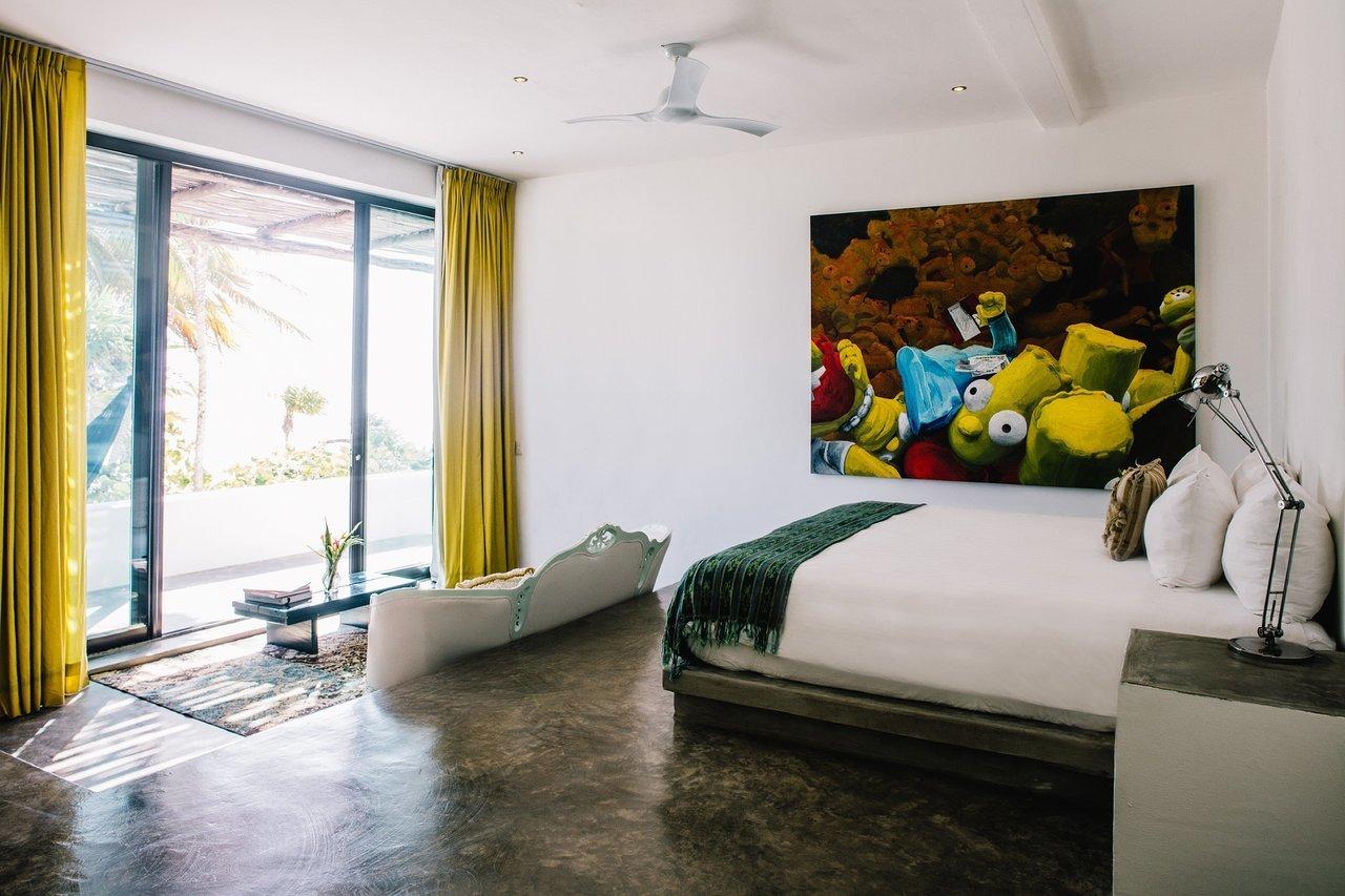 Bedroom, Table Lighting, Lamps, Rug Floor, Bed, Concrete Floor, and Night Stands  Casa Malca