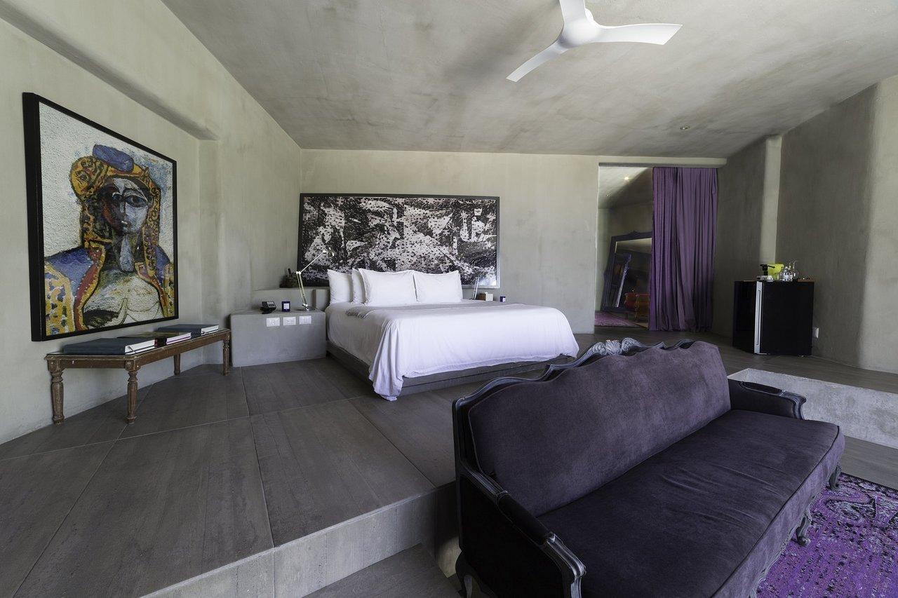 Bedroom, Rug Floor, Lamps, Table Lighting, Night Stands, Bed, and Concrete Floor  Casa Malca