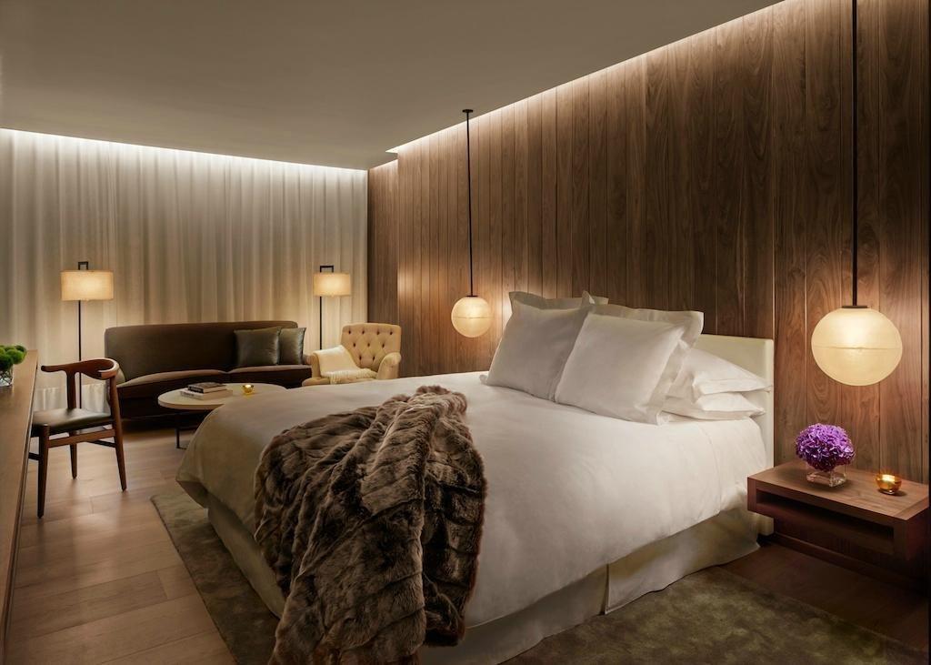 Bedroom, Light Hardwood Floor, Rug Floor, Night Stands, Chair, Lamps, Pendant Lighting, Bed, and Floor Lighting  The London EDITION