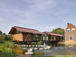 Stepping Stones Lead to This Daylit Dwelling in the Middle of a Pond
