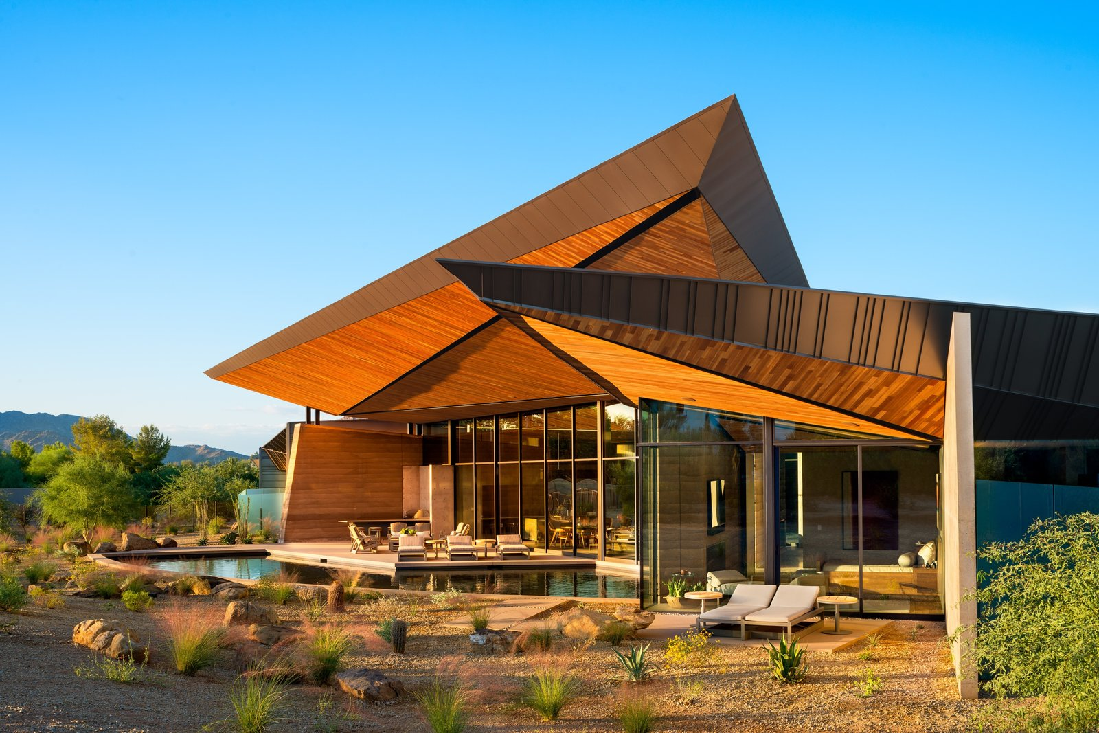 Photo 1 of 14 in A Dramatic Floating Roof Crowns This Rammed-Earth Home in Arizona