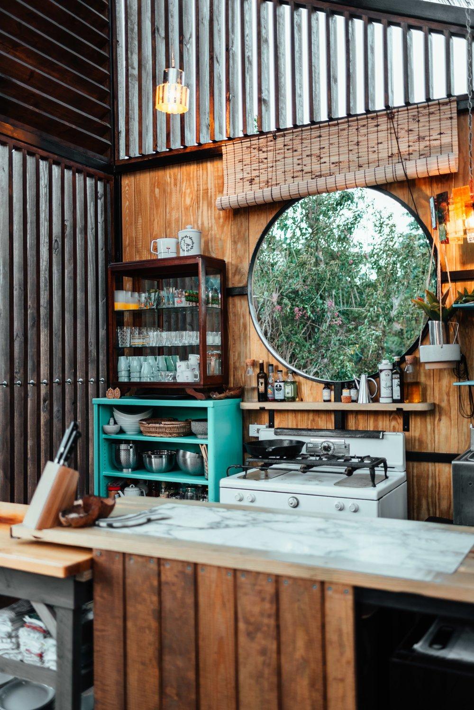 Kitchen, Wood Counter, Pendant Lighting, and Range  La Finca Victoria