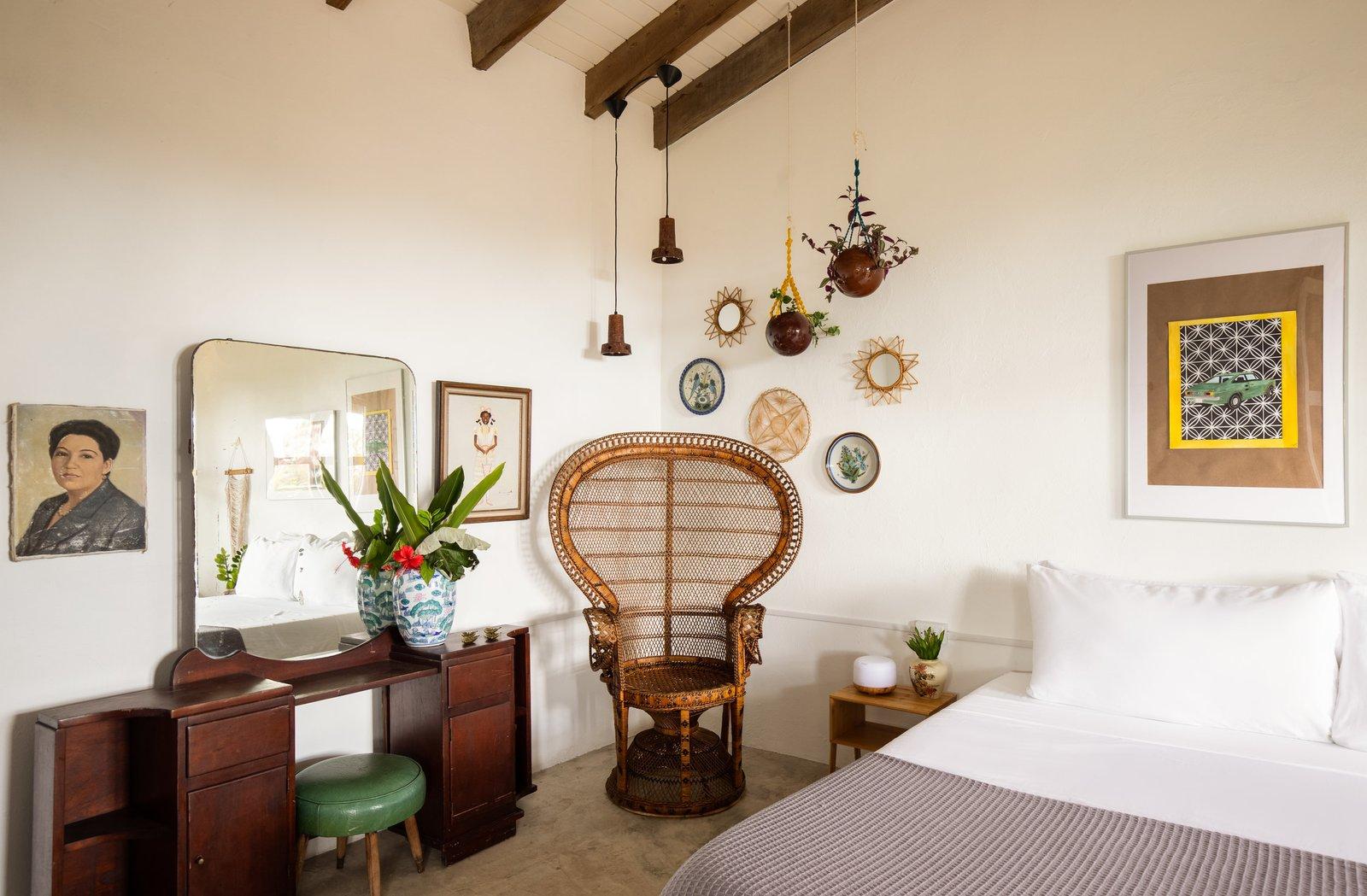 Bedroom, Concrete Floor, Pendant Lighting, Chair, Bed, and Night Stands  La Finca Victoria