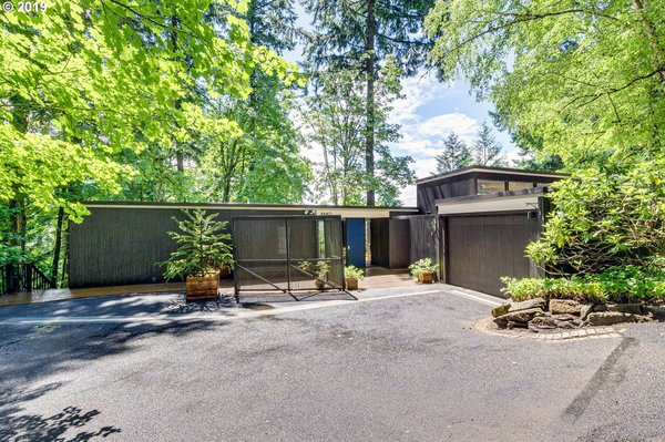 A Marvelous Midcentury With a Bright Blue Door Hits the Market For $1.15M