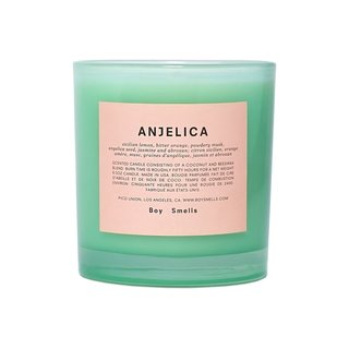 Boy Smells Scented Candle in Anjelica