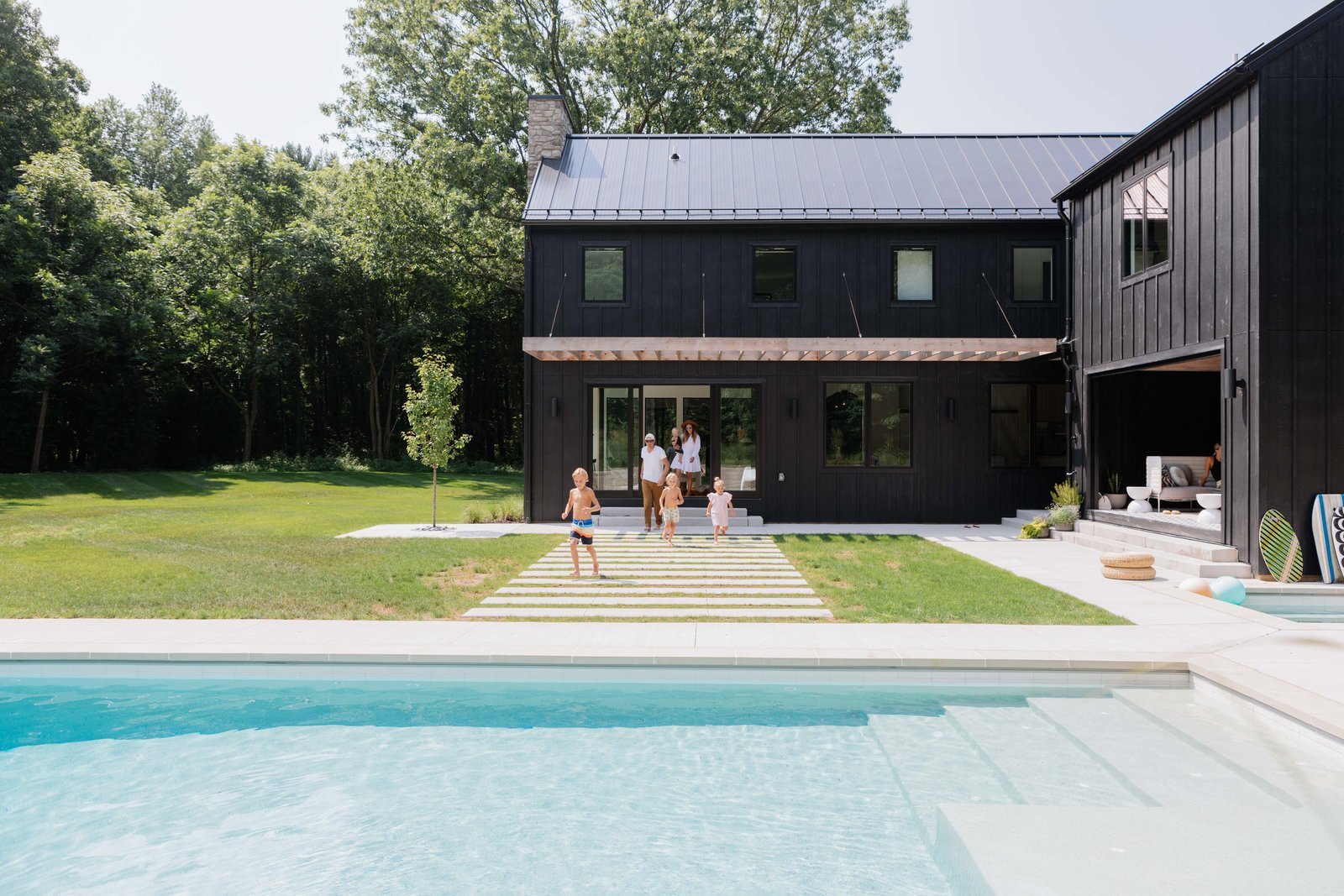 Photo 1 of 10 in Watch How This Danish-Style Farmhouse Unites a Family With Nature
