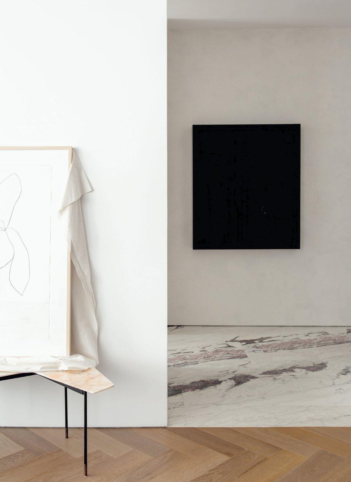 Hallway, Medium Hardwood Floor, and Marble Floor  Photo 6 of 6 in Fashion Designer Philip Lim's NYC Loft Is a Book-Filled Oasis