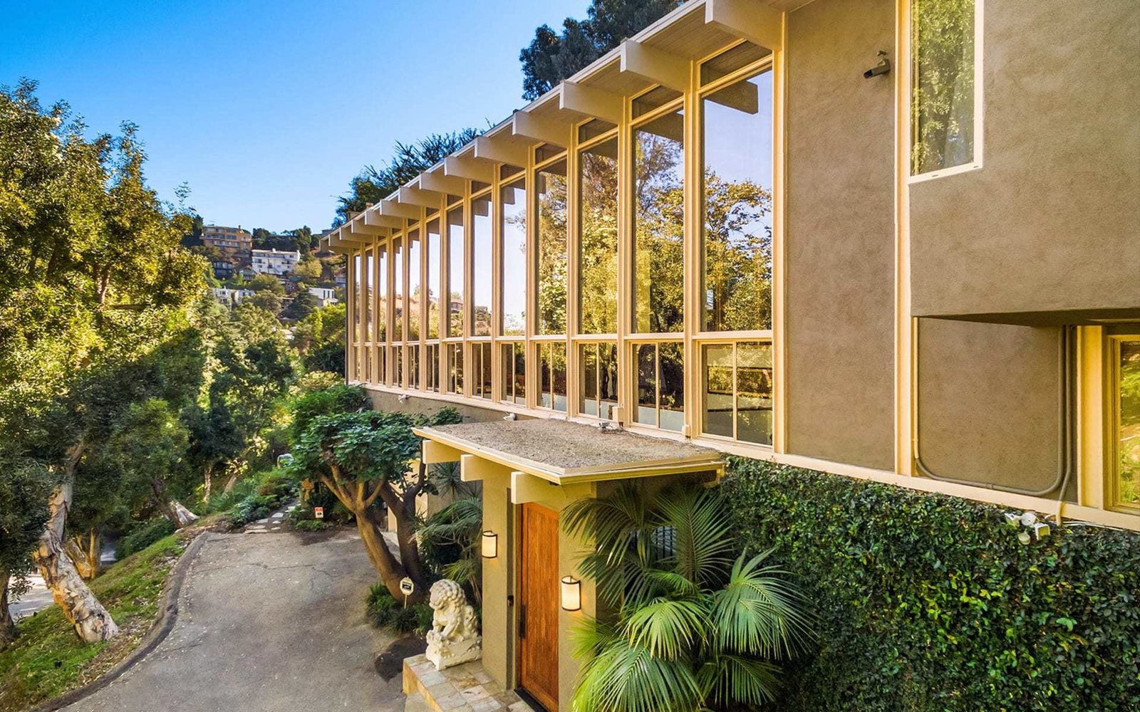 A Lagoon-Style Pool Surrounds This Hollywood Hills Midcentury Home Asking $4.3M