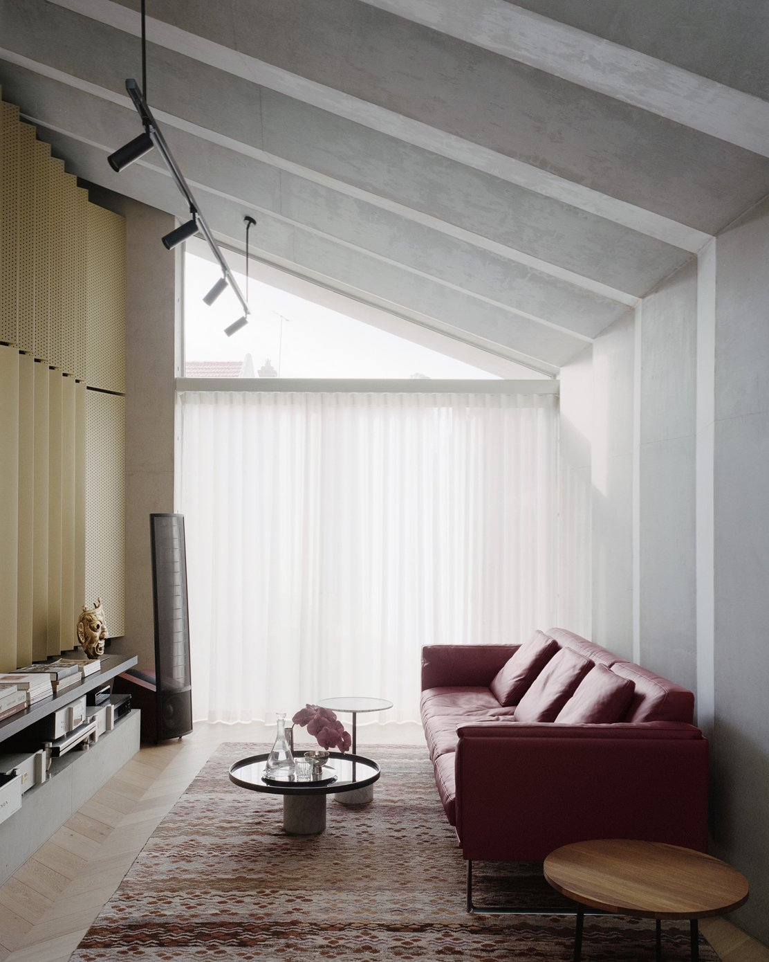 Living, Sofa, Medium Hardwood, End Tables, Rug, Track, Coffee Tables, and Shelves  Living Medium Hardwood Rug Track Photos from A Revamped Terrace House in Sydney Is an Audiophile's Dream