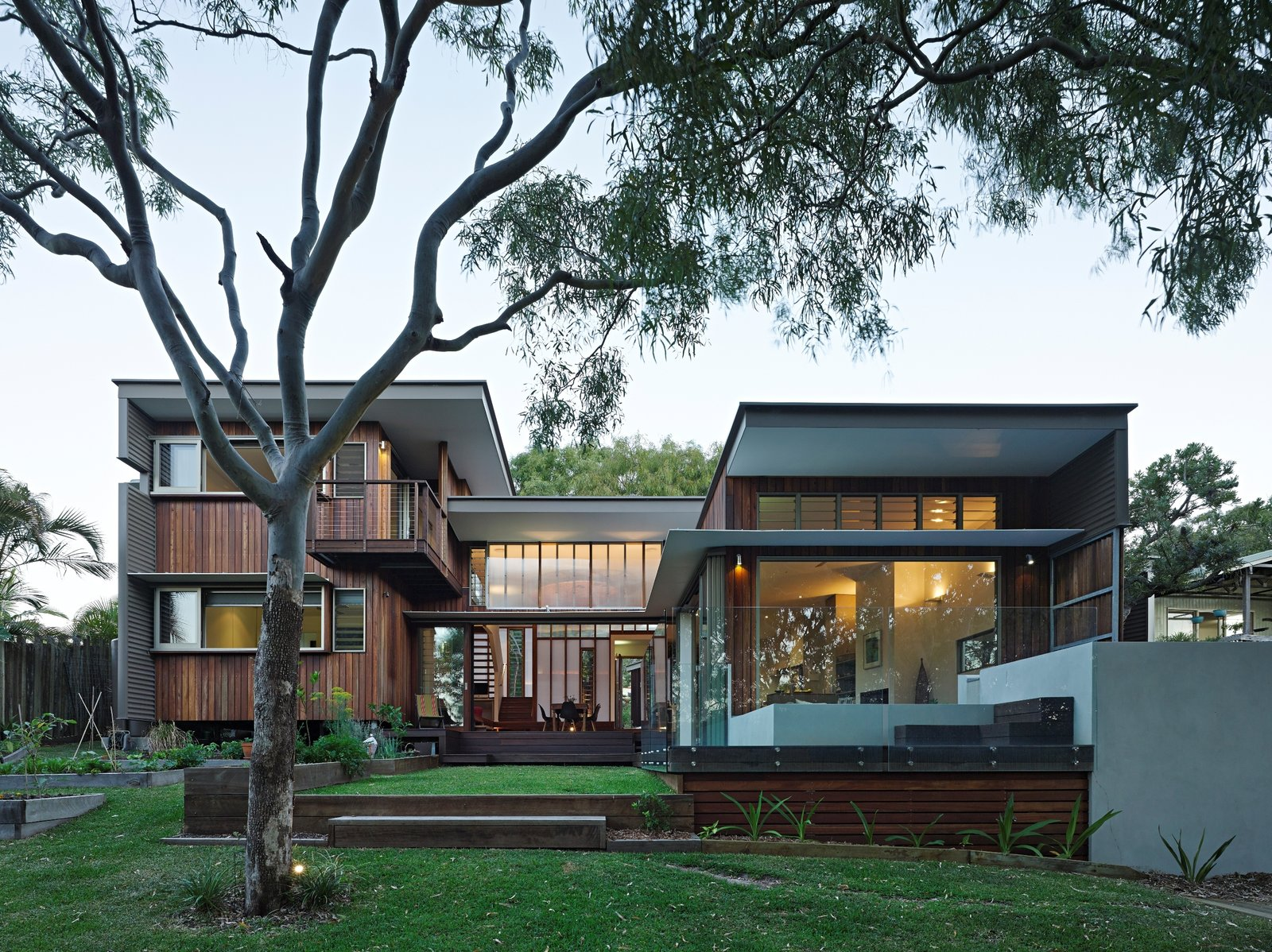 Exterior, House Building Type, Wood Siding Material, and Flat RoofLine  Photo 7 of 10 in Vegetation Cocoons This Tranquil Beach House in Australia