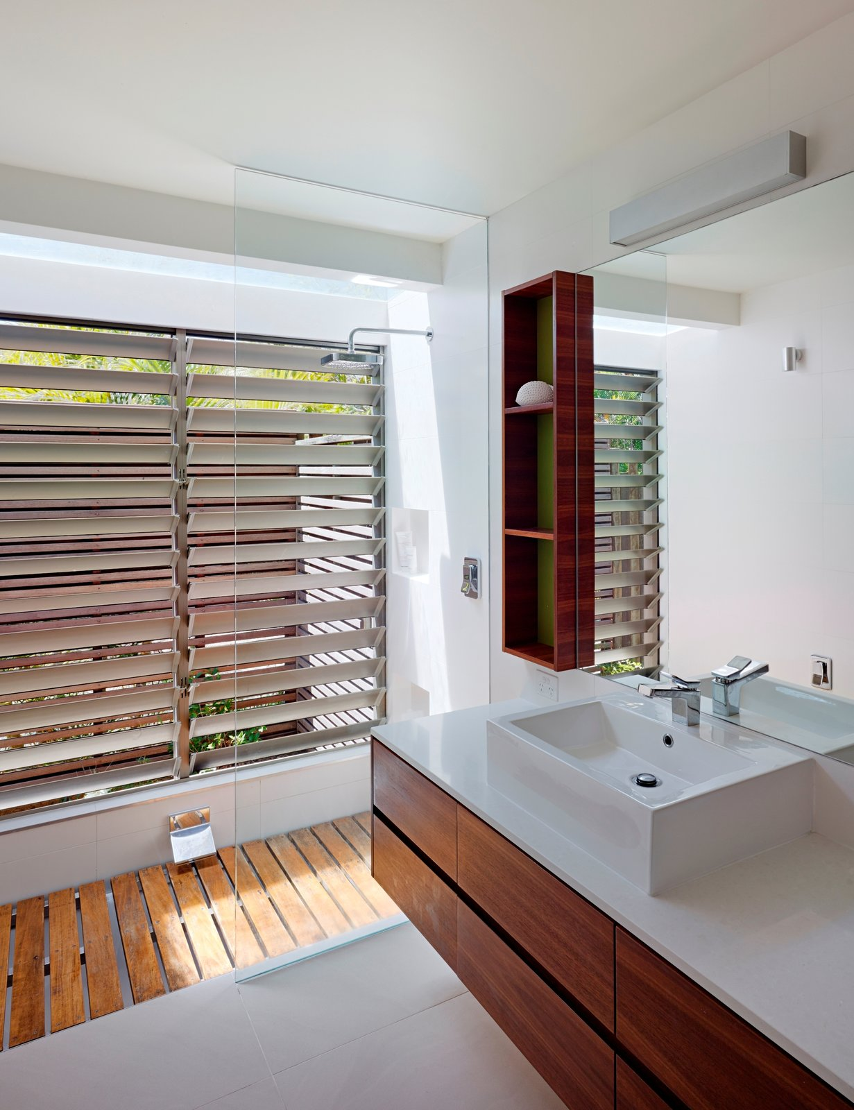 Bath Room, Granite Counter, Open Shower, Wall Lighting, and Vessel Sink  Photo 6 of 10 in Vegetation Cocoons This Tranquil Beach House in Australia