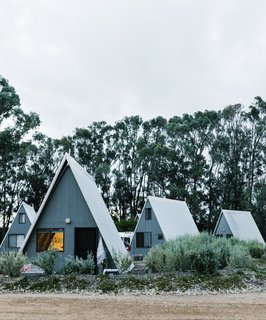A Cluster of A-Frames Hugs White Sand Dunes on Australia's Southwestern Coast