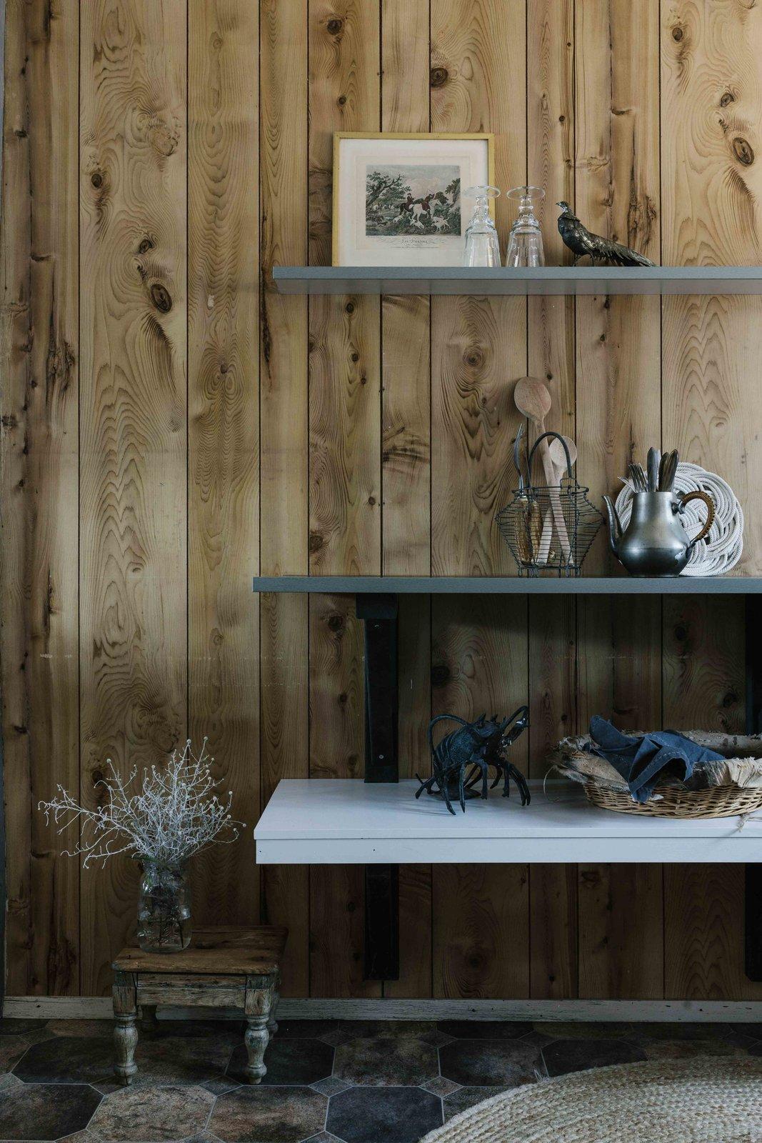 Living Room, Shelves, Porcelain Tile Floor, and Rug Floor  Photo 10 of 13 in A Cluster of A-Frames Hugs White Sand Dunes on Australia's Southwestern Coast