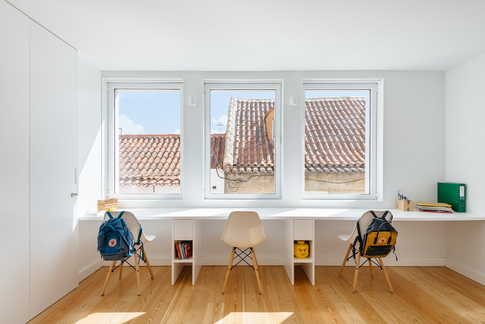 Office, Medium Hardwood Floor, Study Room Type, Craft Room Room Type, and Chair  Photo 17 of 26 in A Hidden Fireman's Pole Is Just One of This Portuguese Home's Many Delights