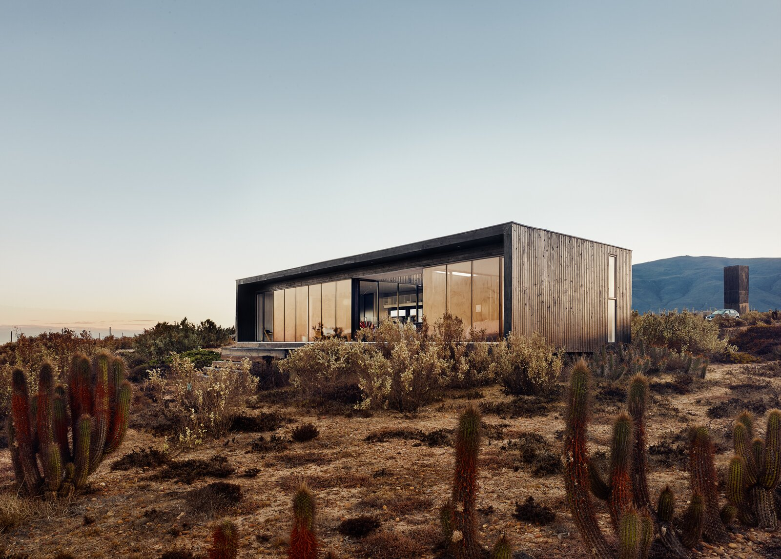 Outdoor and Desert  Photo 1 of 10 in A Streamlined Home in Chile Straddles the Line Between Desert and Ocean
