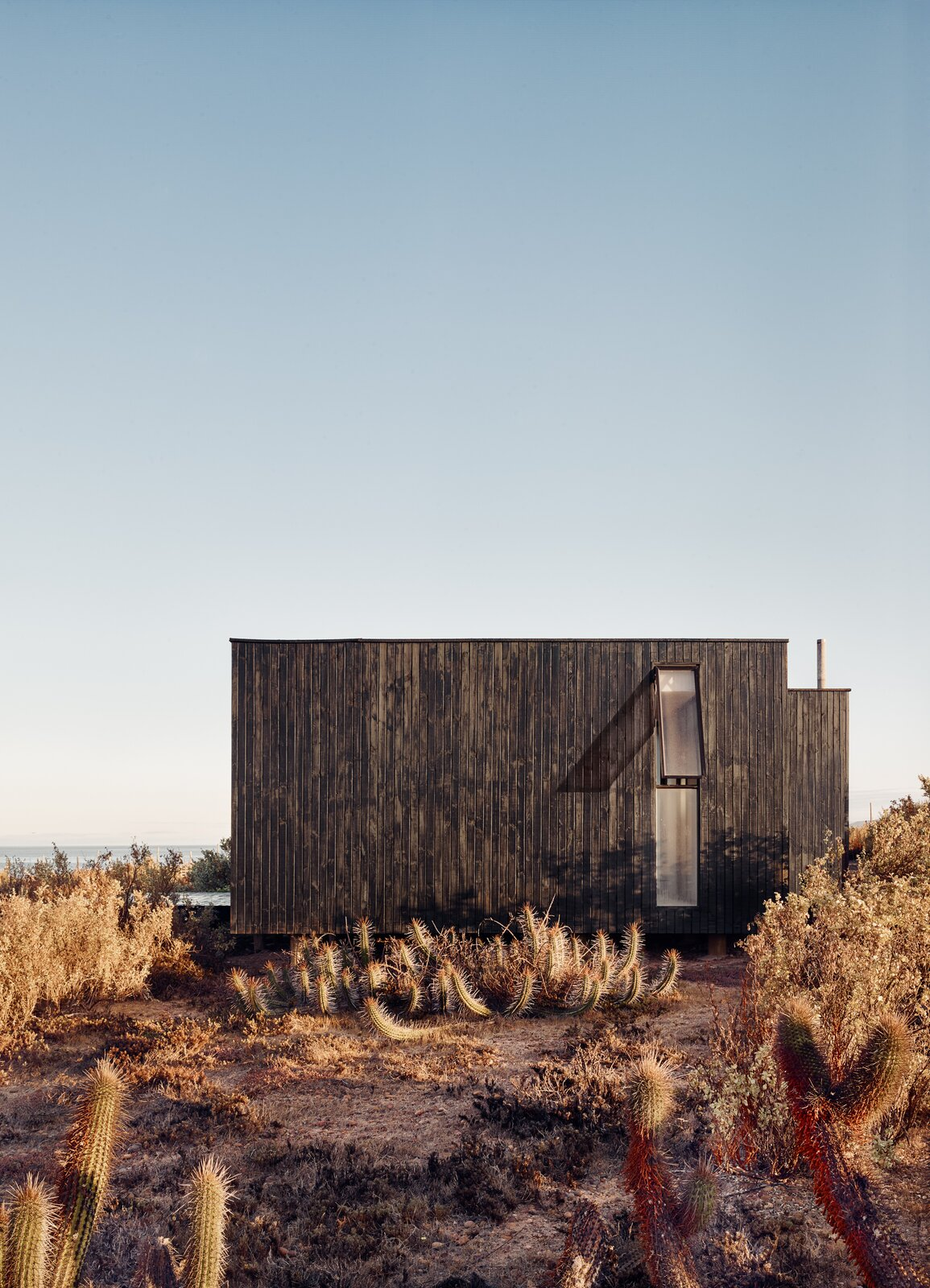Exterior, Flat RoofLine, House Building Type, and Wood Siding Material  Photo 3 of 10 in A Streamlined Home in Chile Straddles the Line Between Desert and Ocean