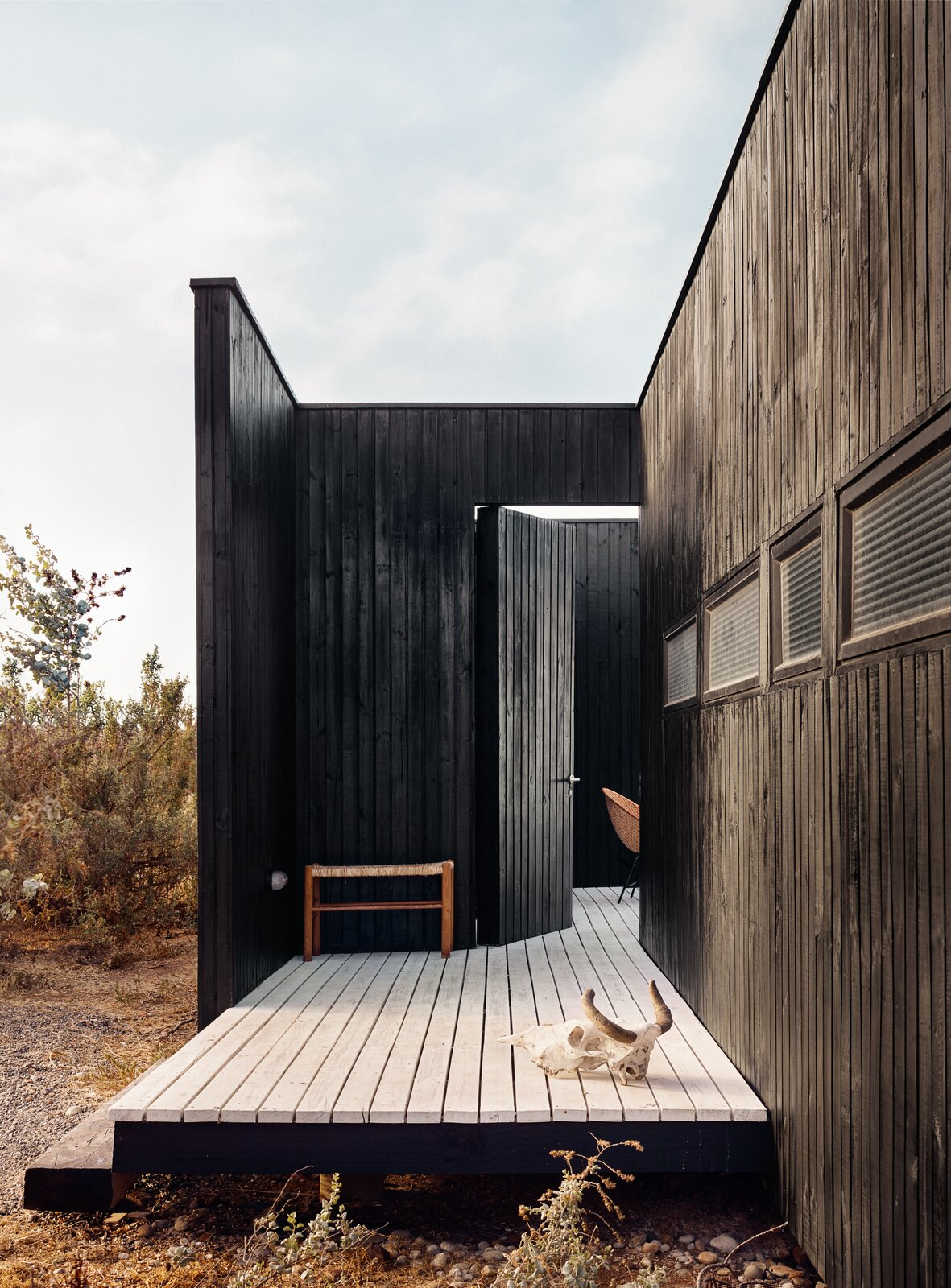 Exterior, Wood Siding Material, House Building Type, and Flat RoofLine  Photo 4 of 10 in A Streamlined Home in Chile Straddles the Line Between Desert and Ocean