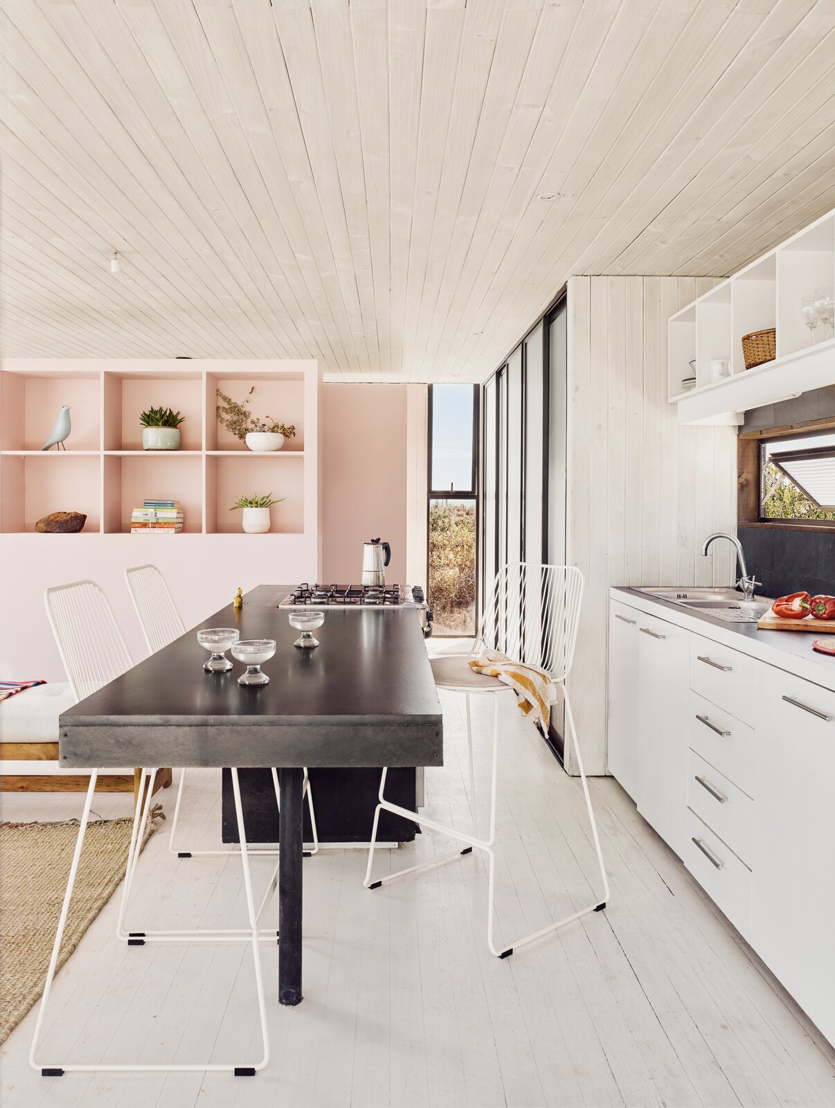 Kitchen, Metal Counter, Recessed Lighting, Drop In Sink, and Light Hardwood Floor  Photo 5 of 10 in A Streamlined Home in Chile Straddles the Line Between Desert and Ocean