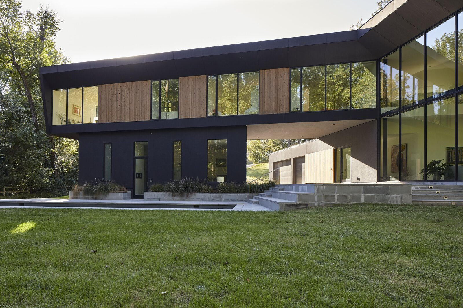 Exterior, House Building Type, and Flat RoofLine  Photo 1 of 14 in At a Young Family's Woodsy Haven, a Soaring Living Space Anchors the Home