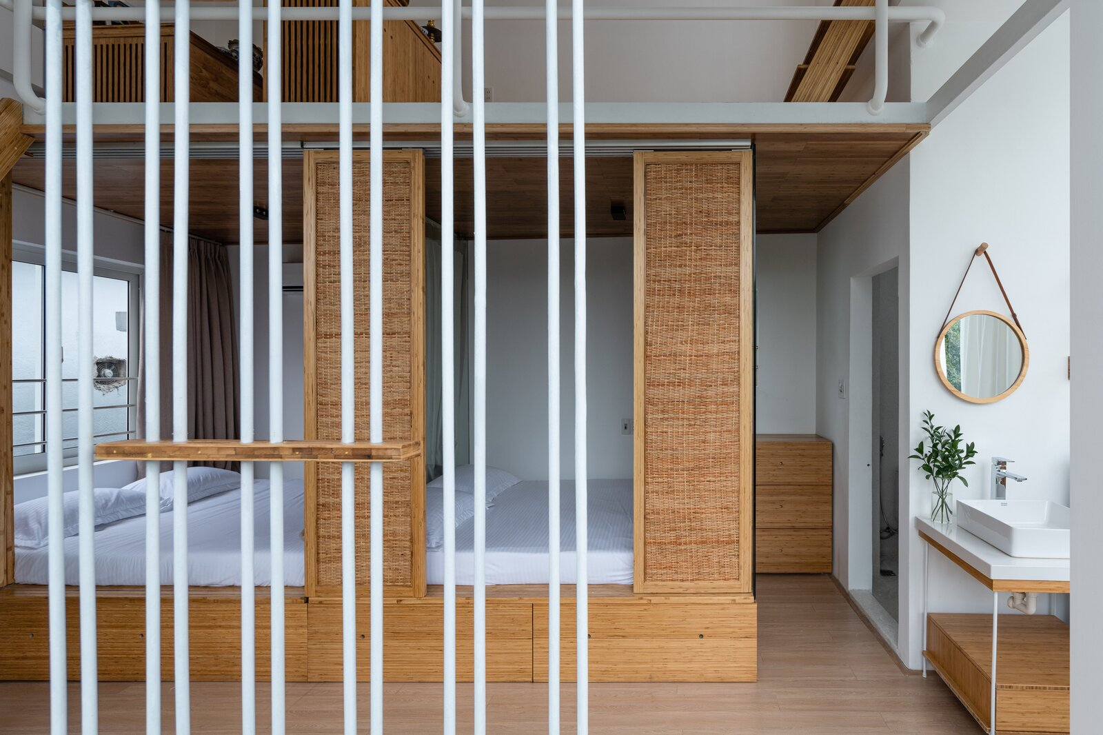 Bedroom, Dresser, Bed, Light Hardwood Floor, and Ceiling Lighting  Photo 14 of 23 in A Translucent Tower in Vietnam Invites Visitors in for a Cup of Coffee