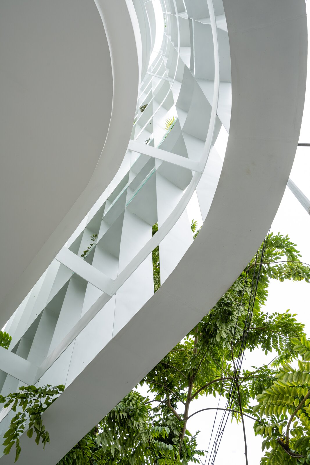 Exterior, Metal Siding Material, and Glass Siding Material  Photo 7 of 23 in A Translucent Tower in Vietnam Invites Visitors in for a Cup of Coffee