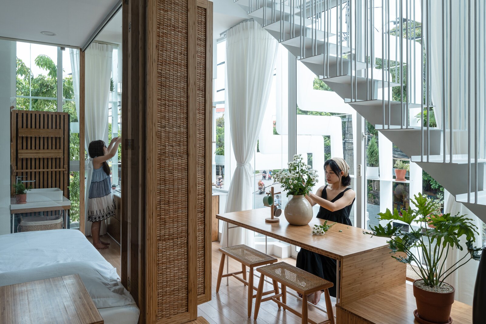 Living Room, Bench, Table, Ceiling Lighting, and Light Hardwood Floor  Photo 16 of 23 in A Translucent Tower in Vietnam Invites Visitors in for a Cup of Coffee